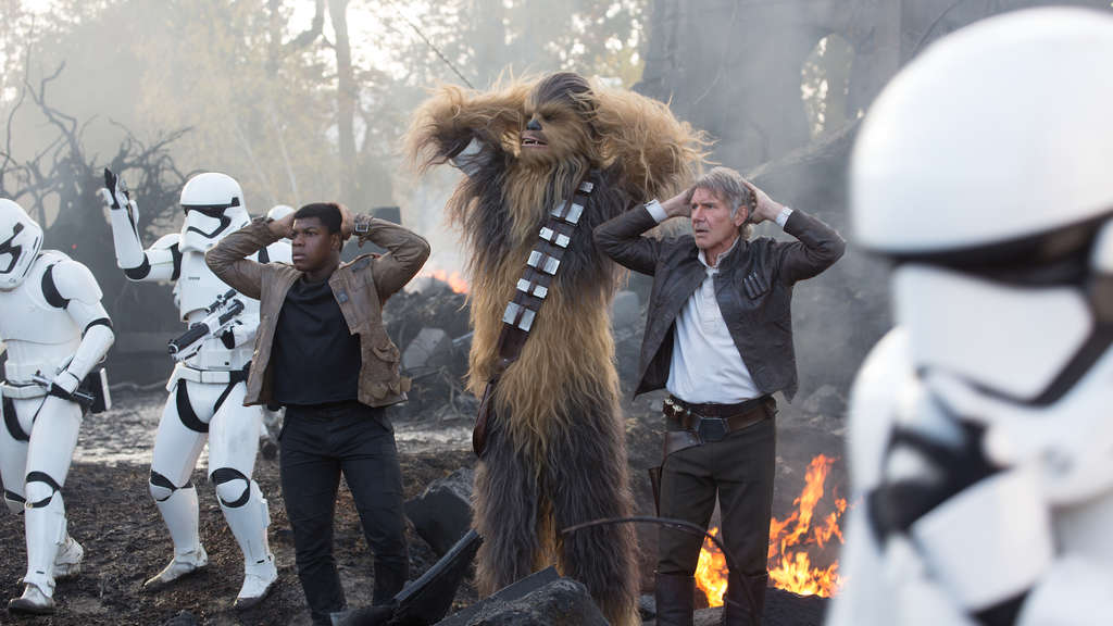 Star Wars: The Force AwakensL to R: Finn (John Boyega), Chewbacca (Peter Mayhew), and Han Solo (Harrison Ford)Ph: David James© 2015 Lucasfilm Ltd. & TM. All Right Reserved.