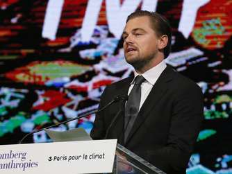 US actor Leonardo Di Caprio delivers a speech at the City hall in Paris during a summit on climat,as part of the World Climate Change Conference 2015 (COP21), on December,4, 2015. / AFP / PATRICK KOVARIK