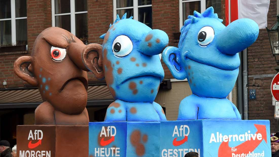 A carnival float, depicting Germany's eurosceptic right-wing populist AfD party metamorphosing from a blue to a brown character, stands in front of the city hall in Duesseldorf, western Germany, after the Rose Monday (Rosenmontag) street parade has been cancelled on February 8, 2016.