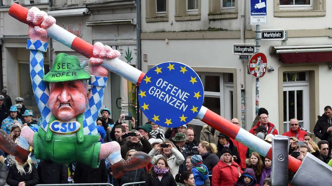 A carnival float, depicting Bavaria's State Premier Horst Seehofer who tries to close the border, stands in front of the city hall in Duesseldorf, western Germany, after the Rose Monday (Rosenmontag) street parade has been cancelled on February 8, 2016.