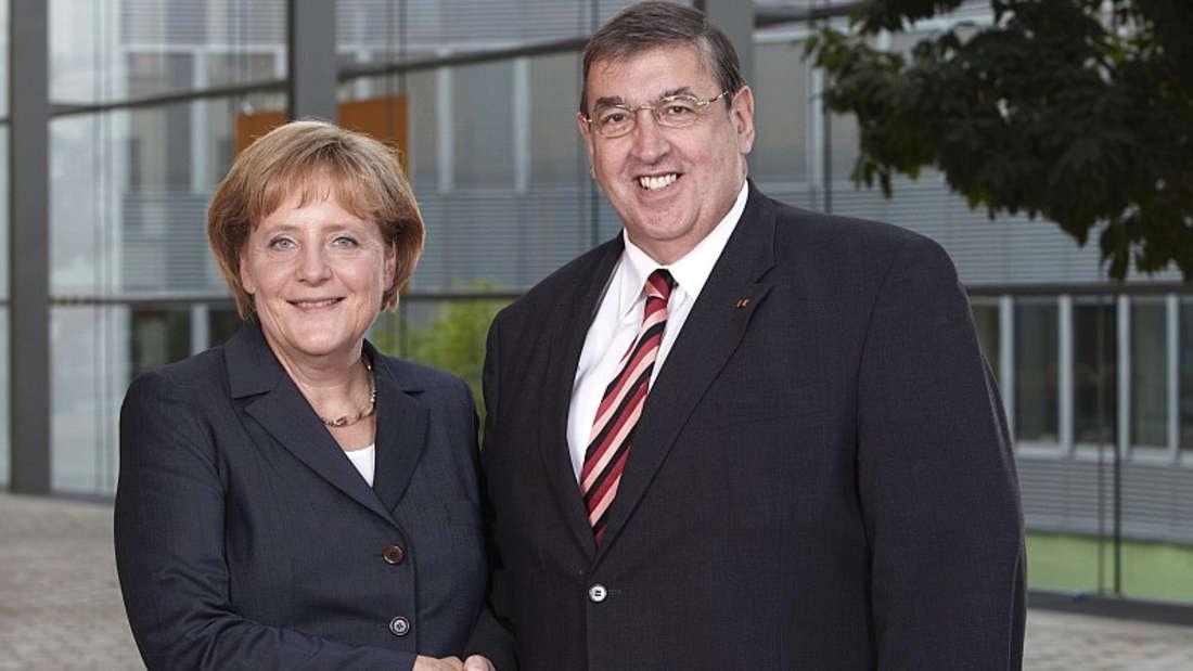 CDU-Sicherheitsexperte Lamers mit Kanzlerin Angela Merkel.