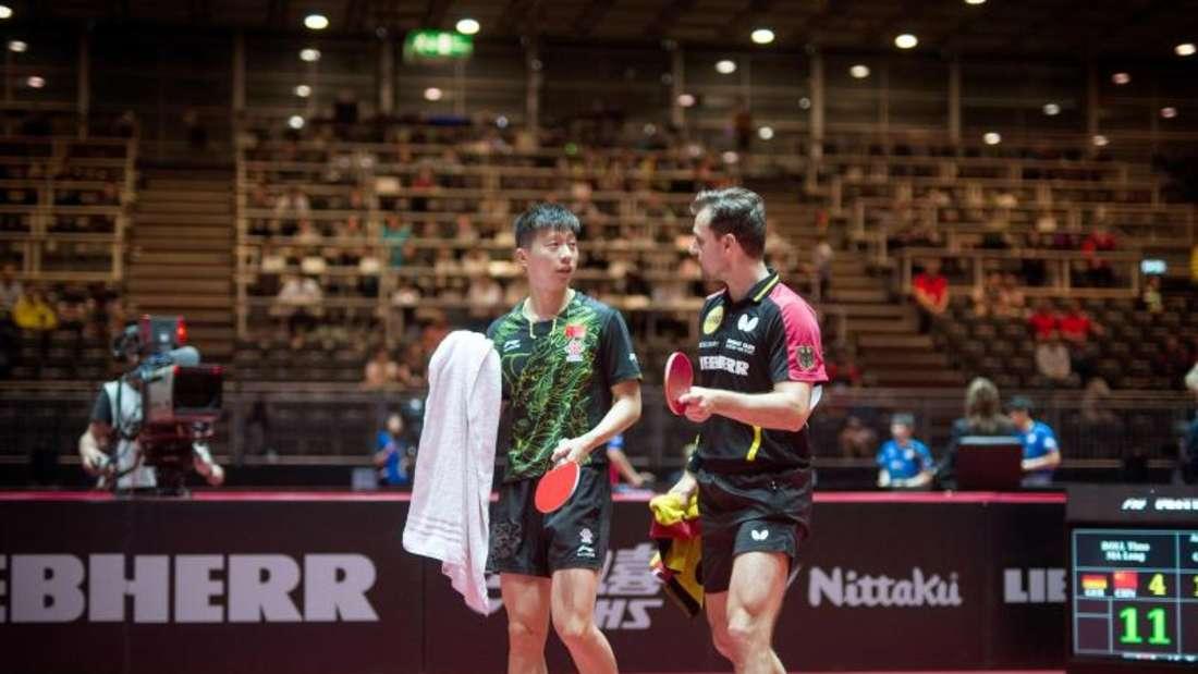 Timo Boll tritt zusammen mit Doppel-Partner Ma Long (l) gegen die Top-Favoriten aus China, Fan Zhendong und Xu Xin, an. Foto: Jonas Güttler