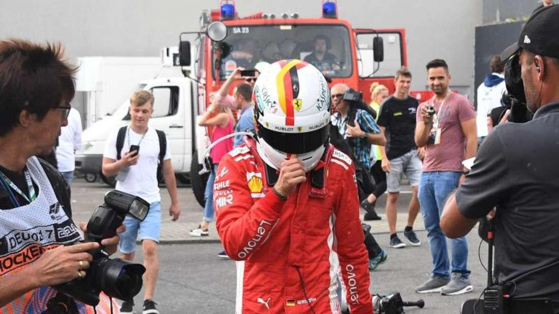 Sebastian Vettel kam mit seinem Ferrari von der regennassen Strecke ab. Foto: Jan Woitas
