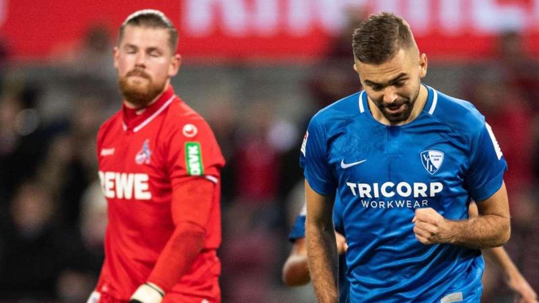 Bochums Torschütze Lukas Hinterseer (r) jubelt nach seinem Treffer zur 1:0-Führung gegen den FC Köln. Links Kölns Torwart Timo Horn. Foto:Marius Becker