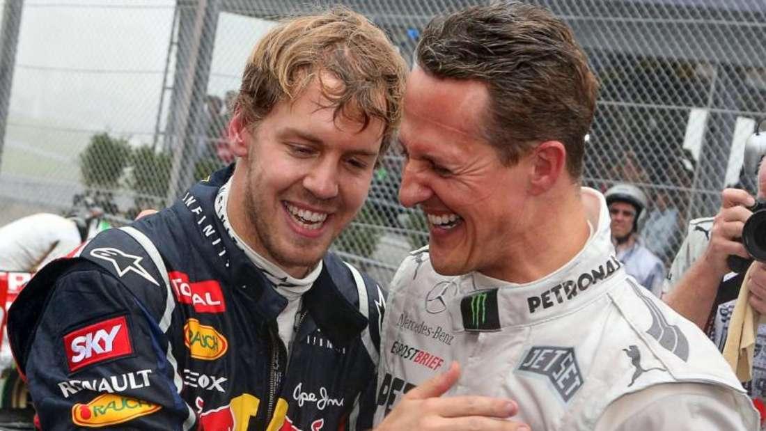 Sebastian Vettel (l) und Michael Schumacher Jahre 2012. Foto: Jens Büttner