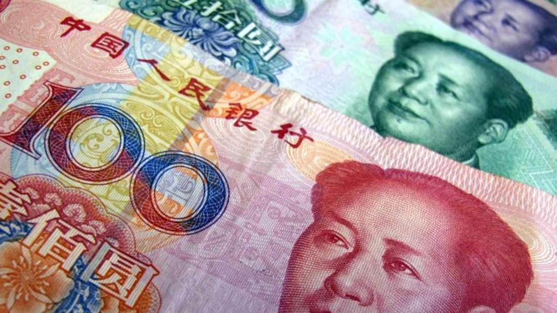 Chinesische Yuan-Scheine mit dem Porträt von Mao Tse-tung. Foto:Karl-Josef Hildenbrand