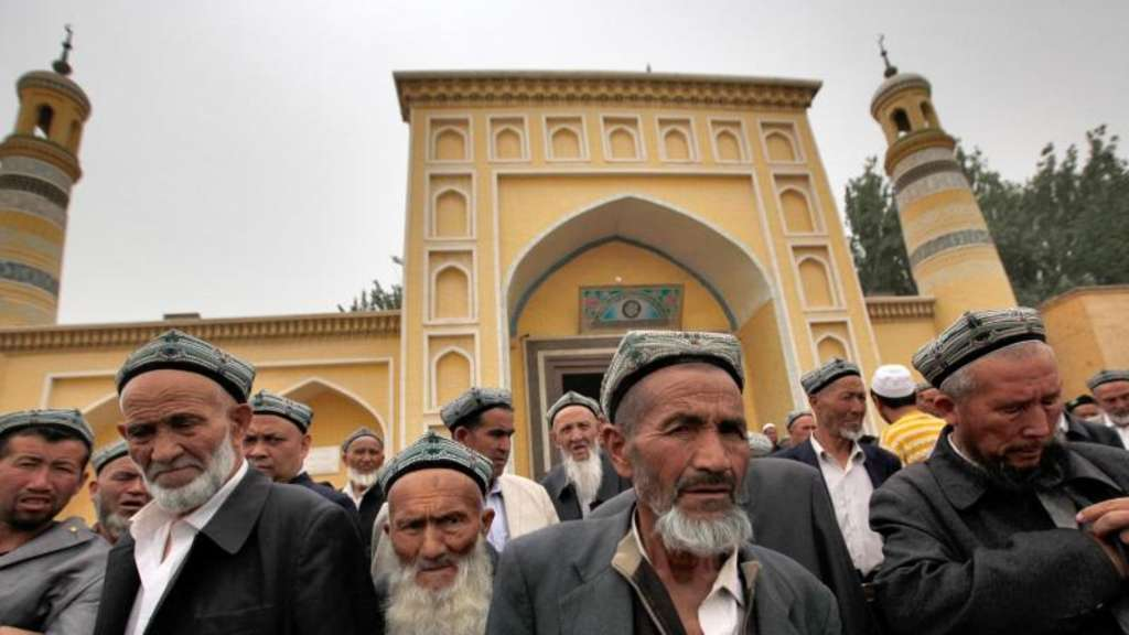 Uiguren in Kashgar im Nordwesten Chinas. Foto: How Hwee Young/EPA/dpa