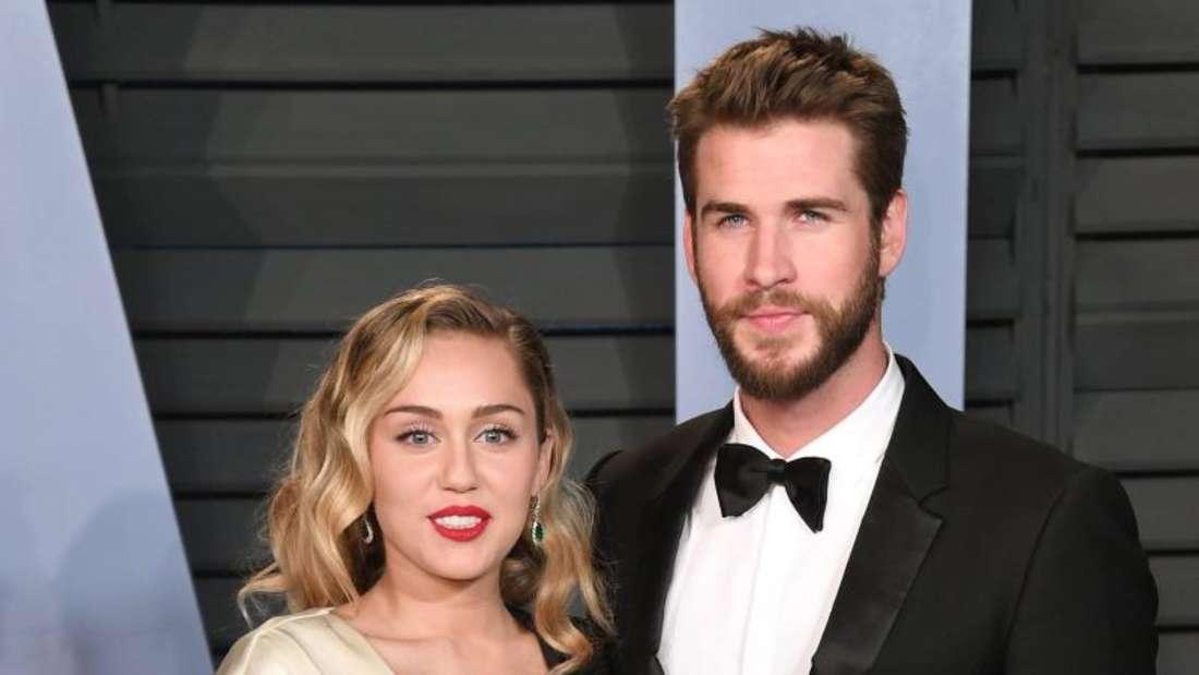 Miley Cyrus und Liam Hemsworth kommen 2018 in Beverly Hills zur Vanity Fair Oscar Party. Foto: -/PA/dpa
