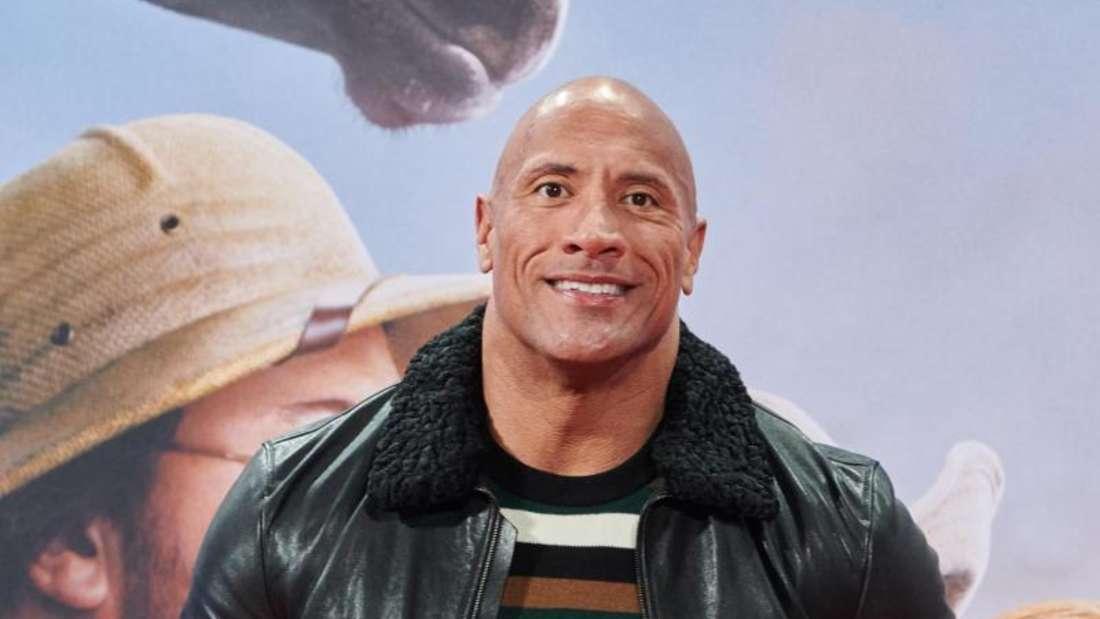 "Dwayne «Tghe Rock» Johnson bei der Deutschlandpremiere des Films ""Jumanji: The next Level"". Foto: Annette Riedl/dpa"