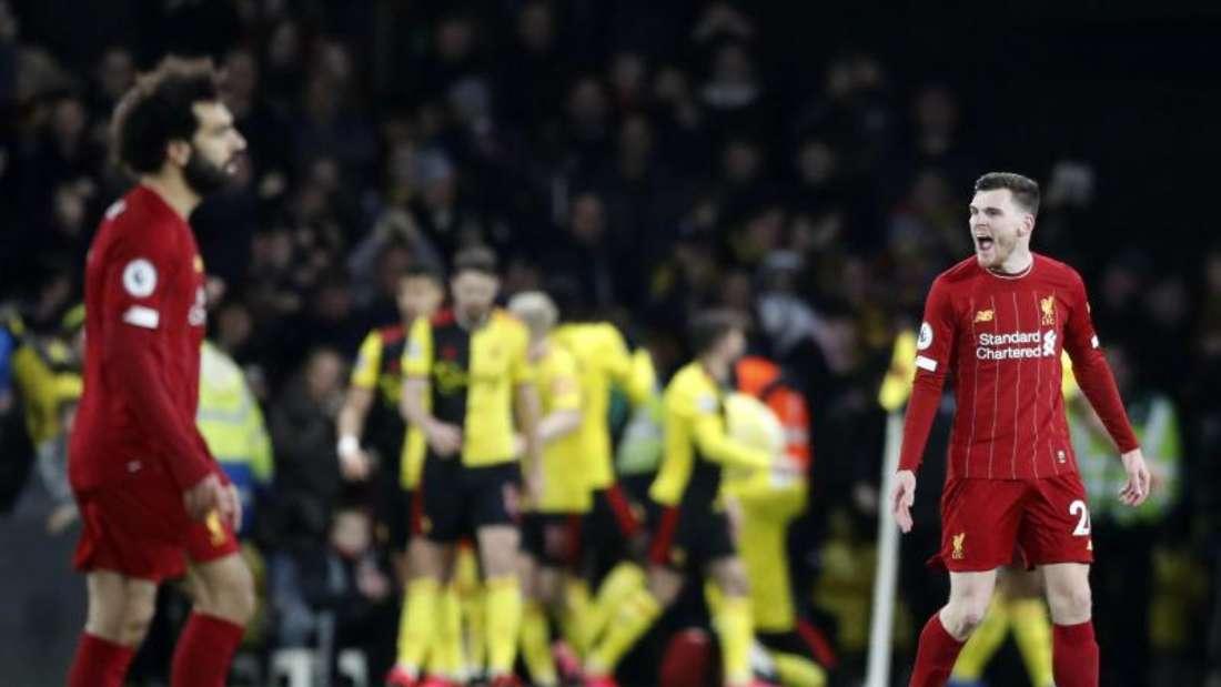 Mohamed Salah (l) und Andrew Robertson vom FC Liverpool zeigen nach dem 0:3 gegen den FCWatford Nerven. Foto: Alastair Grant/AP/dpa