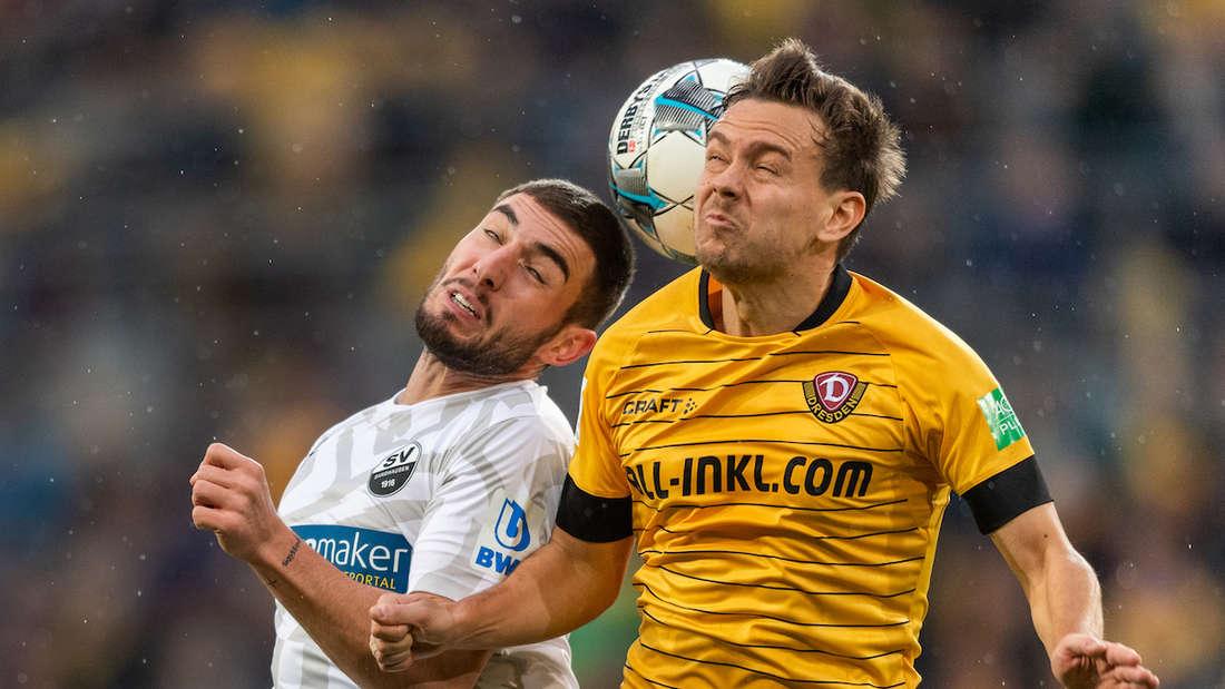 Dynamos Chris Löwe (r) gegen Sandhausens Marlon Frey.
