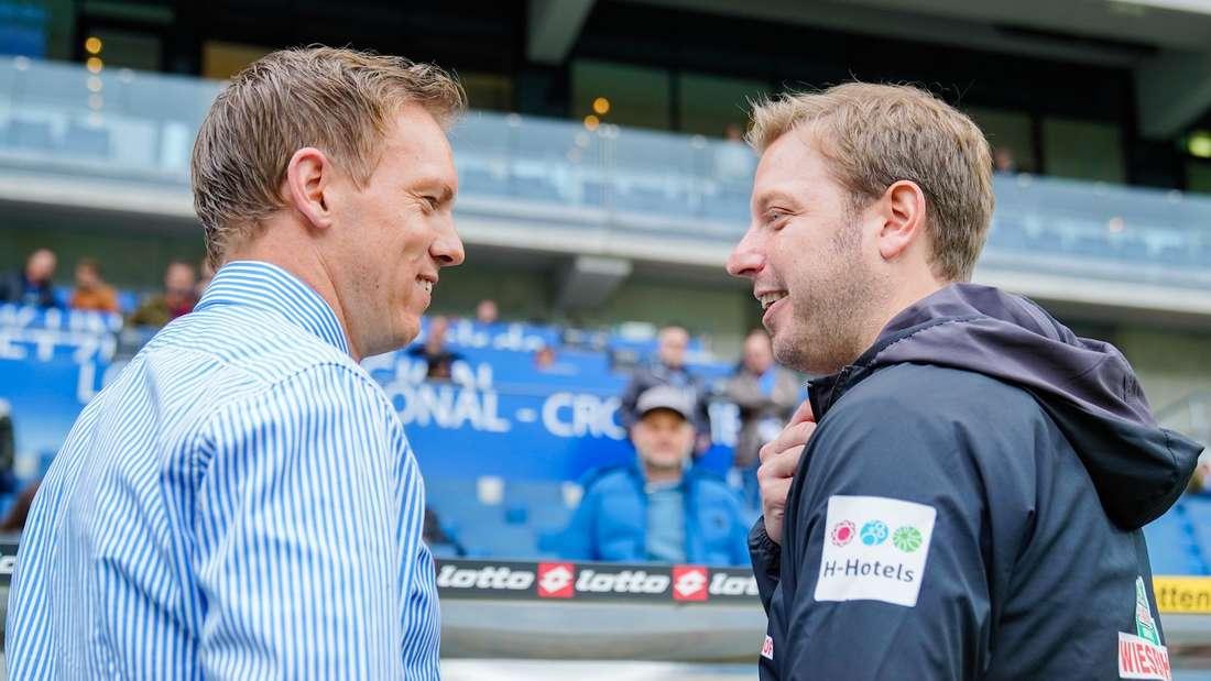 Hoffenheims Trainer Julian Nagelsmann (l) und Bremens Trainer Florian Kohfeldt begrüßen sich.