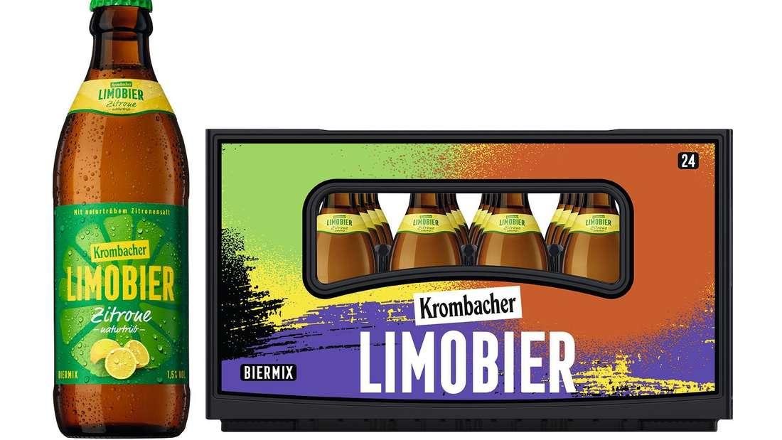 Ein Kasten Limobier von Krombacher. Daneben steht eine Flasche.