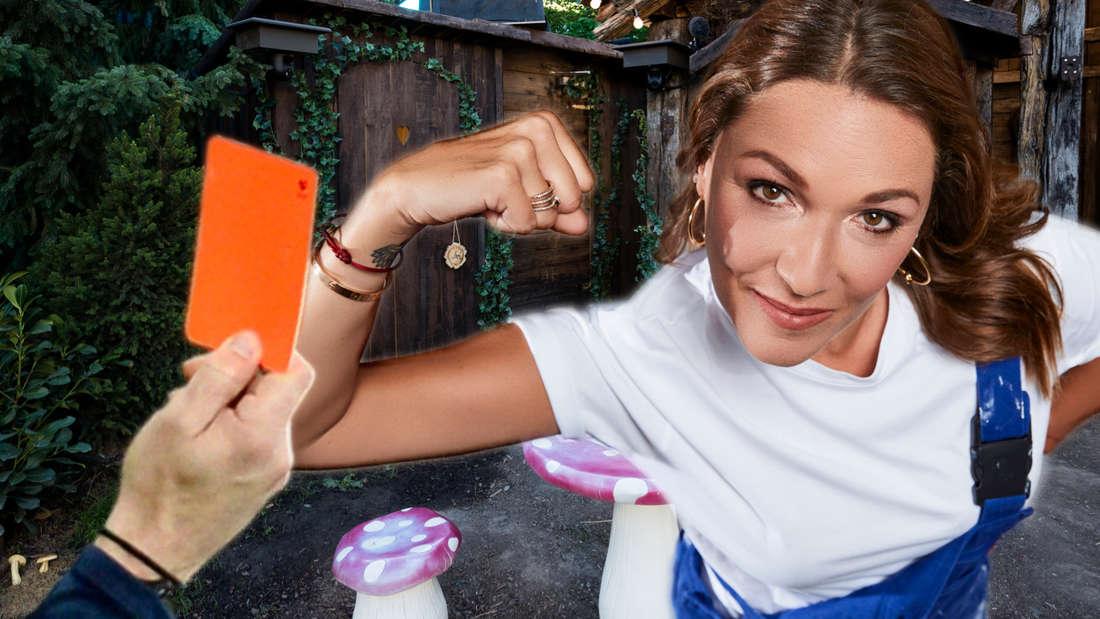 """Simone Mecky-Ballack steht vor dem """"Promi Big Brother""""-Märchenwald. Links sieht man eine rote Karte."""